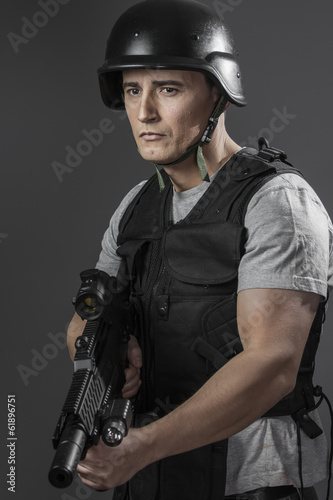 Recreation, paintball sport player wearing protective helmet aim