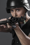 Gunfire, paintball sport player wearing protective helmet aiming