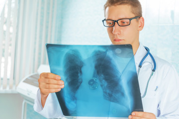 Physician looks at x-ray picture