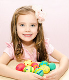 Smiling little girl with colorful easter eggs