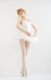 Beautiful girl dressed as a ballerina. Fashion makeup. Stylish h
