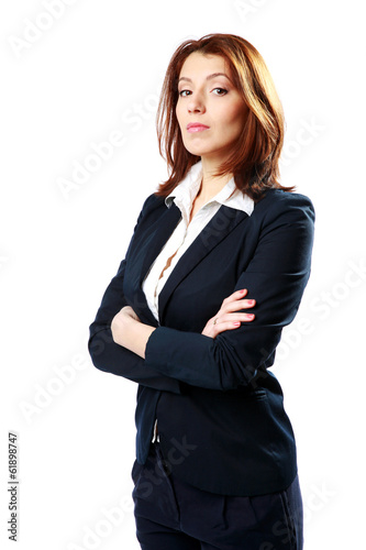 Pensive businesswoman standing with arms folded