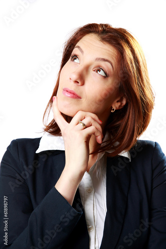 Portrait of a pensive businesswoman looking up