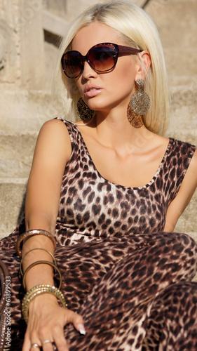 sexy blond woman in sunglasses in leopard dress