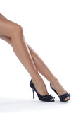 Female's legs with shoes. White background
