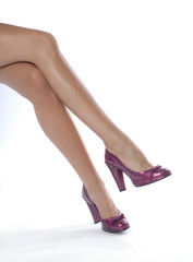 Female legs with shoes. White background