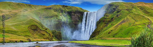 Tuinposter Watervallen beautiful torrent of skogafoss...