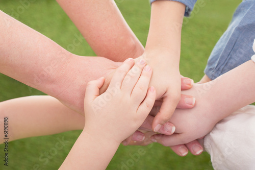 family hands lying on each other