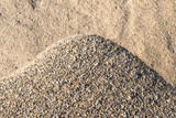 Closeup of a pile of sand and gravel in varied colors and shapes