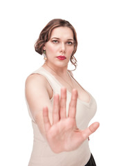 Plus size woman making stop gesture