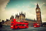 Fototapety London, the UK. Red bus in motion and Big Ben