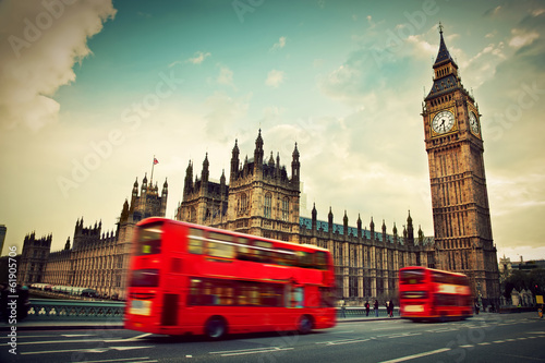 London London, the UK. Red bus in motion and Big Ben
