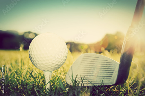Playing golf, ball on tee and golf club. Vintage, retro style