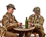 an English soldier and an American soldier playing cards