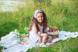 Happy beautiful little girl in white dress on grass background