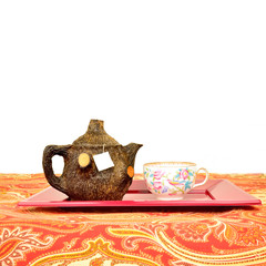 rustic teapot and cup isolated