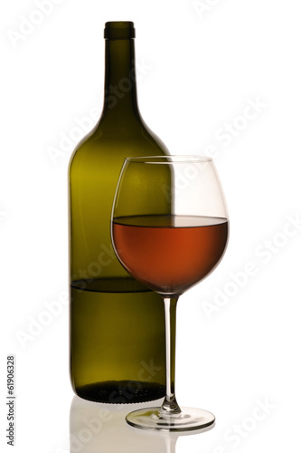 Special orange wine bottle with glass