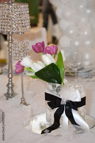 Tulips and crystal lamps decorating the table