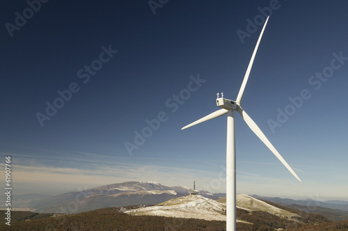 Wind turbines with beautiful landscape behind
