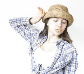 modest girl in shirt and hat