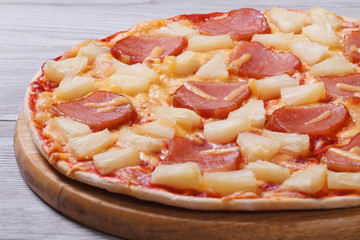 juicy Hawaiian pizza with pineapple and ham