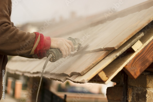 Roofer - Sanding Roof Tiles