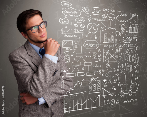 Attractive man looking at stock market graphs and symbols