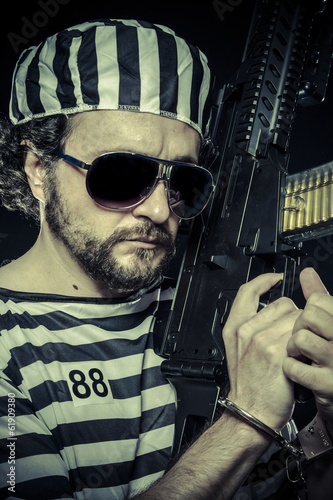 Weapon, Prison riot concept. Man holding a machine gun, prisoner