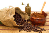 Coffee beans,bag,ground coffee,spoon,little heart and grinder
