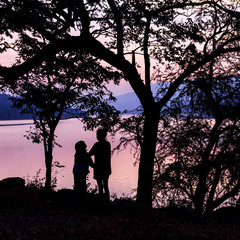 silhouette love mom and son with dusk