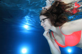 Woman underwater  with glasses