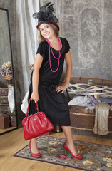 Vintage style girl with red handbag