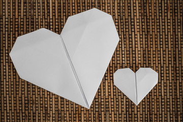 Origami Hearts on Brown Rattan