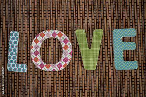 Love Text Written on Brown Rattan