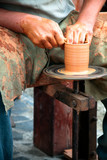Potters Wheel. Creating a clay mug by hand