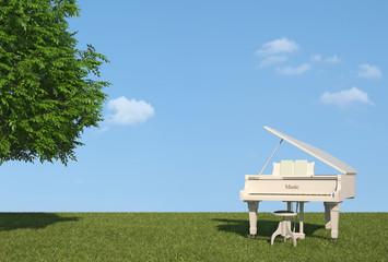 White grand piano on grass