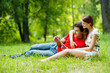 Beautiful romantic couple with tablet pc at summer green park