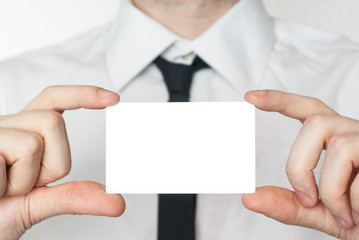 Man in tie showing and holding a card