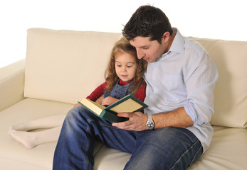 Father telling fairy tale to cute little daughter