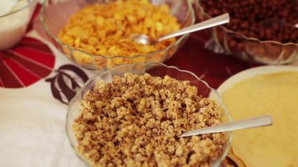 Breakfast table, pancakes, jam, cereal, yoghurt