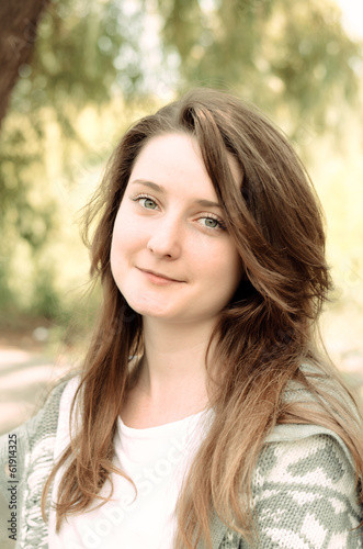 Attractive young woman with an amused smile