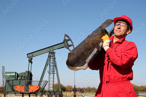 The Oilfield Worker At Well Pump Jack Site.