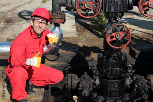 The Oilfield Worker Showing Ok Sign.