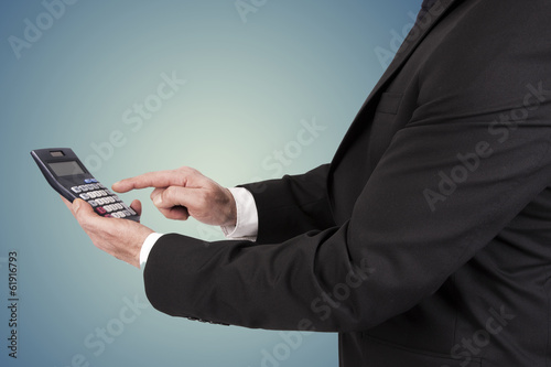 businessman and finance working with calculator in hand