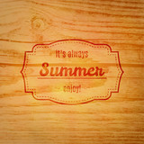 Summer label over wooden background