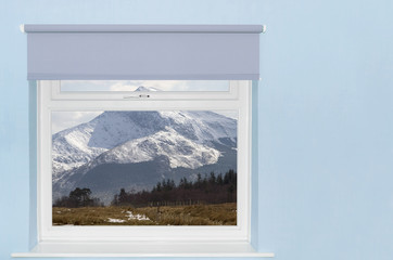 View of snow covered mountain from window