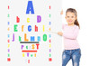 Young child pointing on colorful eyesight test with wooden stick