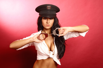 Beautiful brunette as policewoman in the studio