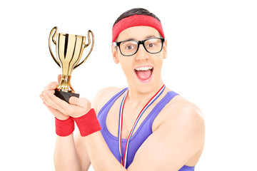 Young male champion holding a trophy