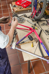 Real bicycle mechanic cleaning bike parts